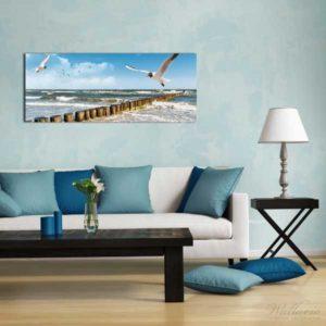 Glasbild Strand Fliegende Möwe Wohnansicht Couch